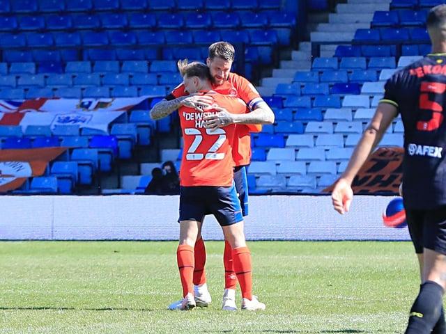 Sonny Bradley hugs Kiernan Dewsbury-Hall after the Hatters beat Watford this season