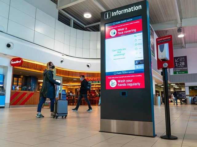 Digital kiosks give information to help passengers move around the airport