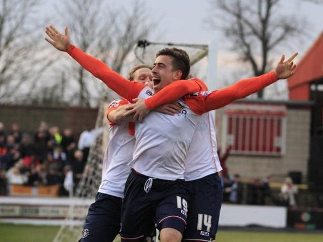 Olly Lee celebrates scoring for the Hatters