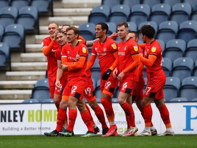 Luton's players celebrate their winner at Preston North End last season