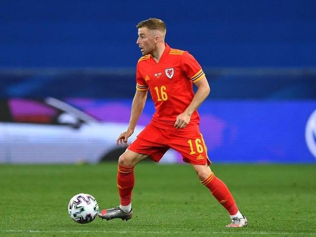 Luton midfielder Joe Morrell in action for Wales