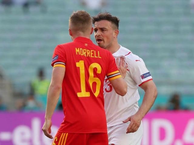 Luton midfielder Joe Morrell clashes with Xherdan Shaqiri of Switzerland