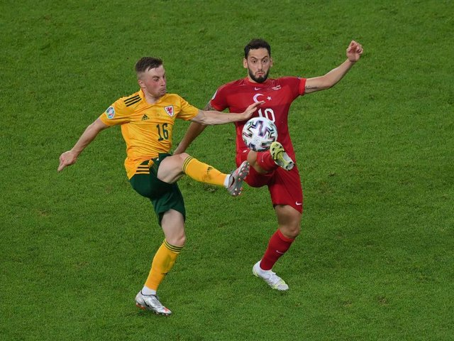 Joe Morrell wins possession against Turkey for Wales this evening
