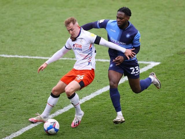 Fred Onyedinma challenges James Bree during Luton's 3-1 win at Adams Park last season