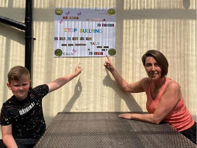Alfie, 10, shows his poster with Brewery Tap landlady Gabrielle McKeown