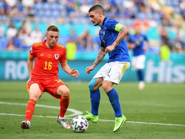 Joe Morrell gets close to Italy's Marco Verratti during yesterday's Euro 2020 clash