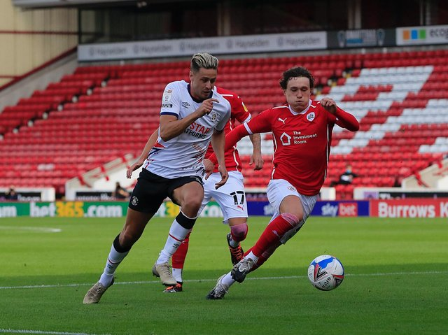 Harry Cornick tries to sprint away in Luton's opening Championship game at Barnsley last season
