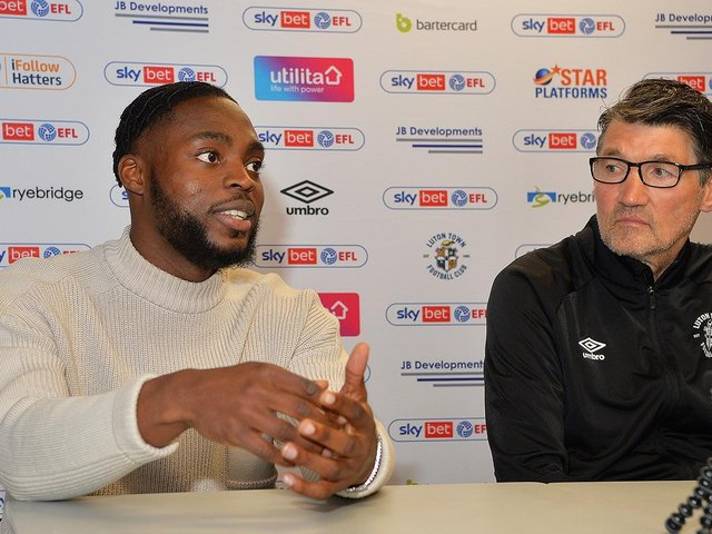Town attacker Fred Onyedinma with Luton assistant boss Mick Harford