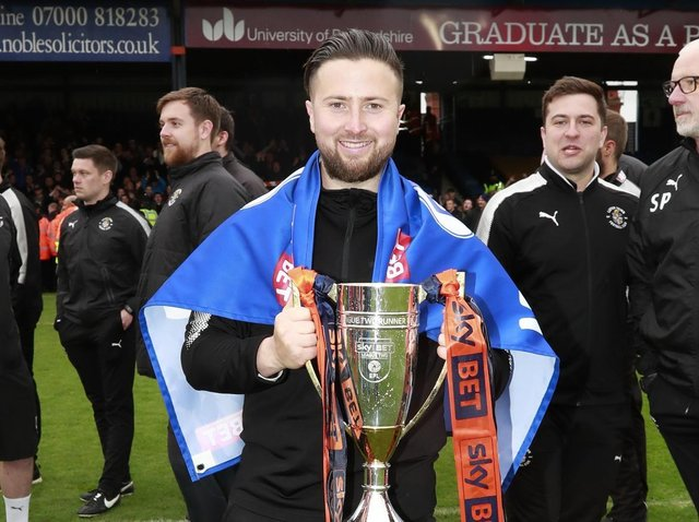 Jared Roberts-Smith celebrates winning promotion from League Two in 2018