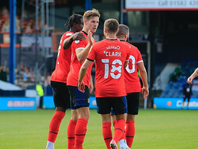 James Collins celebrates one of his 72 goals for the Hatters