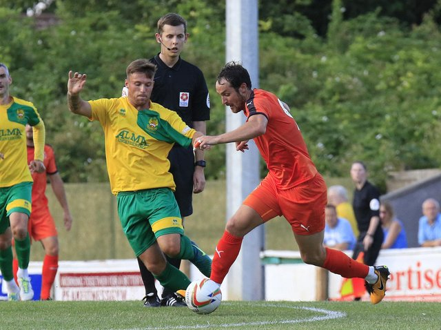 Danny Hylton gets forward against Hitchin back in the summer of 2018