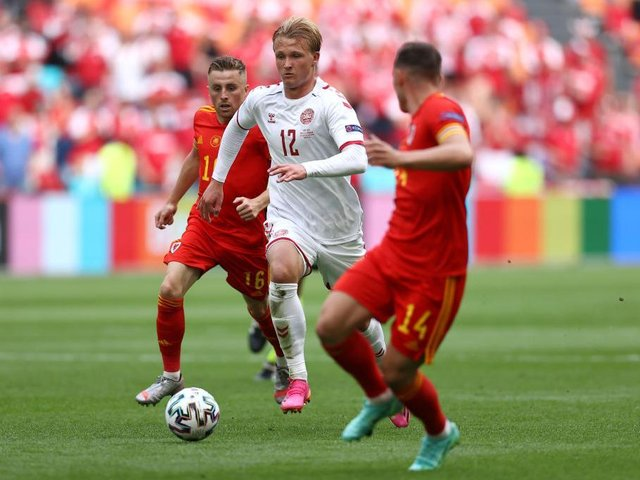 Joe Morrell in action as Wales lost in the Euro 2020 second round to Denmark yesterday