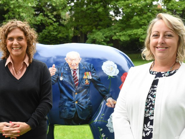 Captain Sir Tom Moore's daughter Hannah (left) and Keech CEO Liz Searle (right) with the sculpture dedicated to his memory
