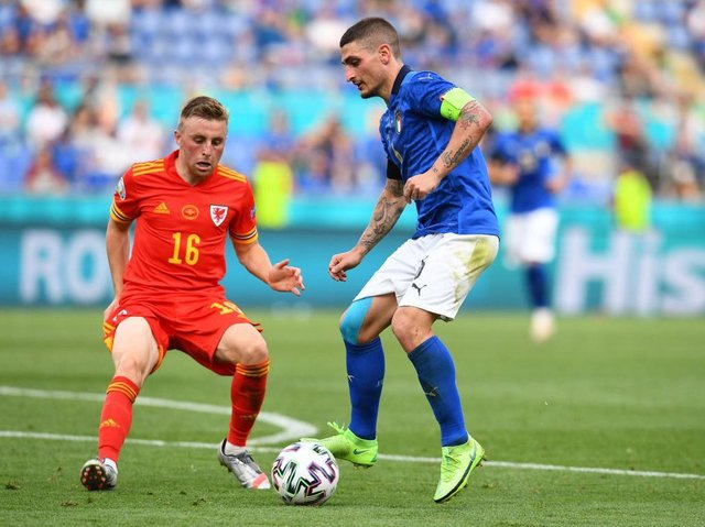 Joe Morrell in action for Wales against Italy at the Euros