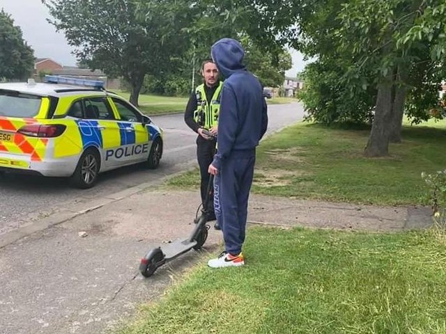 Police educate a rider about the laws surrounding e-scooters