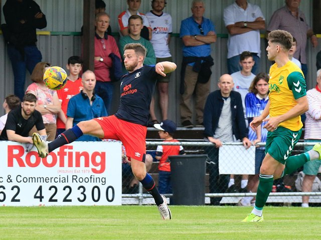 Town midfielder Jordan Clark stretches to control the ball at Hitchin on Saturday