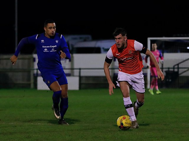 Town defender Corey Panter in action