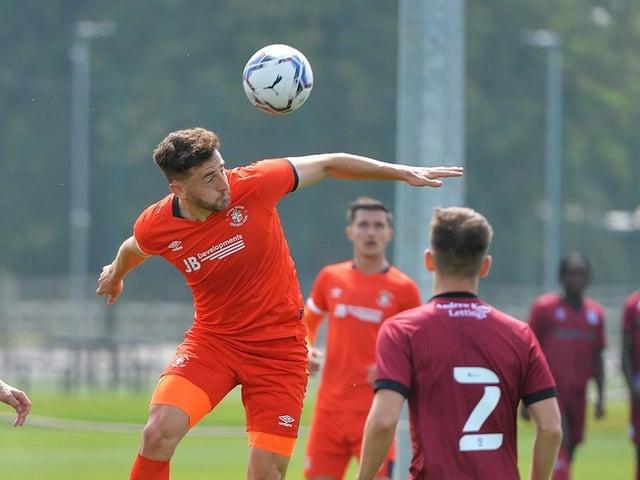 Tom Lockyer wins a header against Rochdale on Saturday