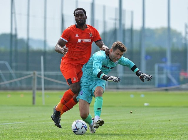 Town striker Cameron Jerome challenges the Rochdale keeper on Saturday