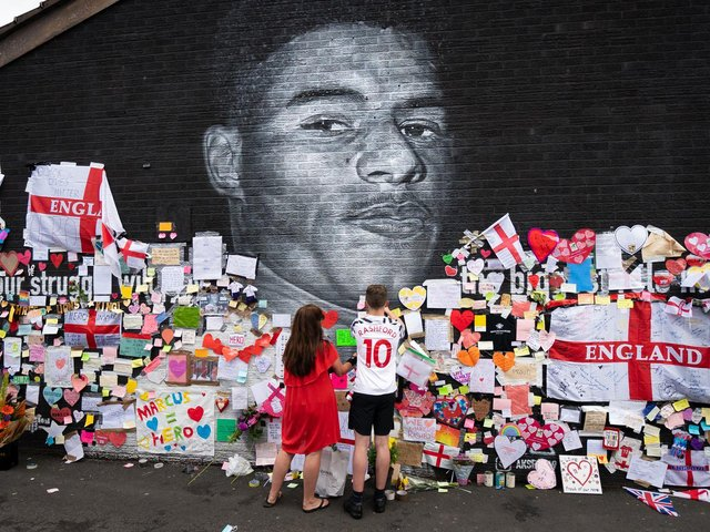 Messages of support and solidarity were left on the mural of footballer Marcus Rashford in Manchester, after it was defaced following England's Euro 2020 final defeat
