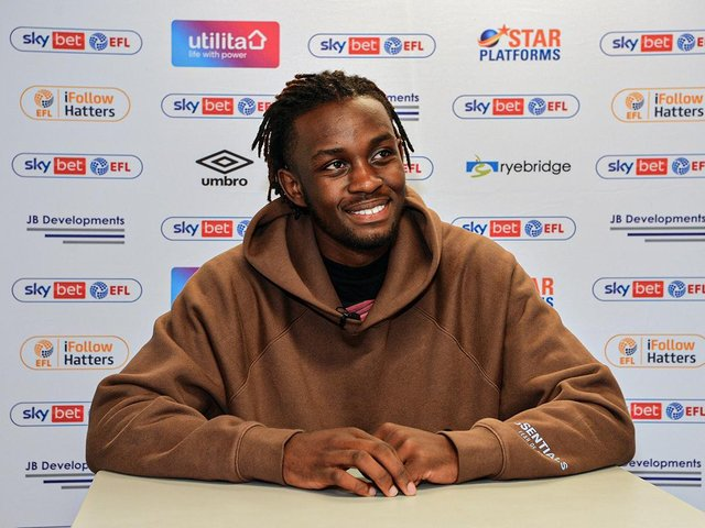 Admiral Muskwe signs for the Hatters