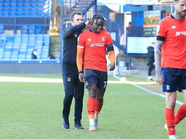 Nathan Jones with midfielder Pelly-Ruddock Mpanzu