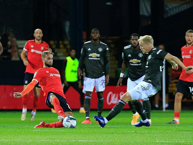 Andrew Shinnie slides in to make a challenge against Manchester United last season