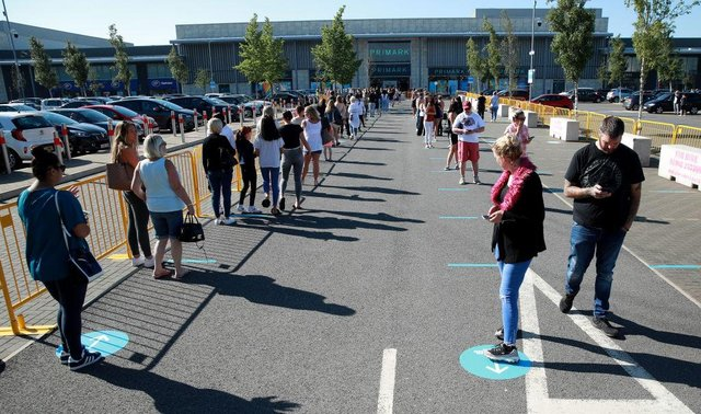 Thousands of shoppers were seen queuing for reopened shops in England