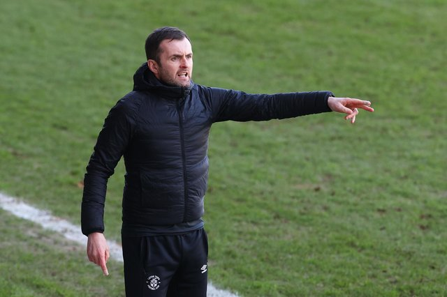 Nathan Jones, manager of Luton Town, gives their team instructions during the Sky Bet Championship match between Luton Town and Sheffield Wednesday at Kenilworth Road on February 27, 2021.