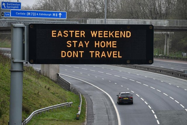 An overhead sign on the M8 advises people not to travel this Easter Weekend (Photo: Jeff J Mitchell/Getty Images)