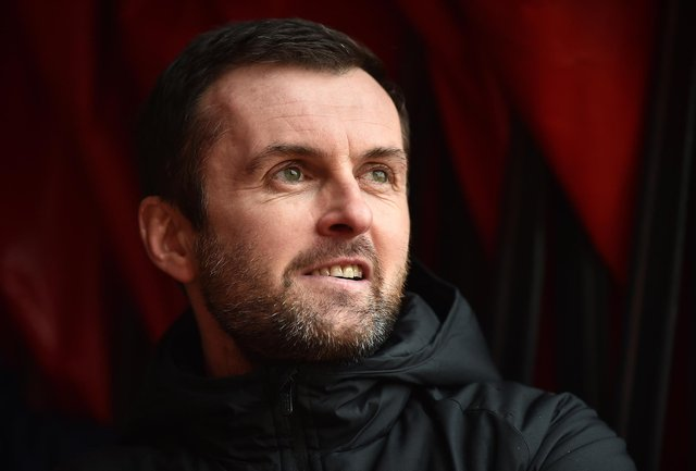 Nathan Jones, manager of Luton Town looks on prior to the Sky Bet Championship match between Stoke City and Luton Town at Bet365 Stadium on February 20, 2021.