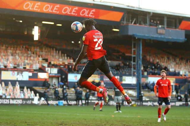 LUTON, ENGLAND - FEBRUARY 27: Elijah Adebayo of Luton Town scores their side's third goal during the Sky Bet Championship match between Luton Town and Sheffield Wednesday at Kenilworth Road on February 27, 2021 in Luton, England. Sporting stadiums around the UK remain under strict restrictions due to the Coronavirus Pandemic as Government social distancing laws prohibit fans inside venues resulting in games being played behind closed doors. (Photo by Julian Finney/Getty Images)